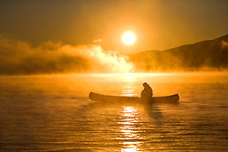 Canoeing at sunrise, Moosehead Lake, Maine.