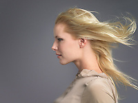 Woman Facing the Wind hair billowing behind profile close-up