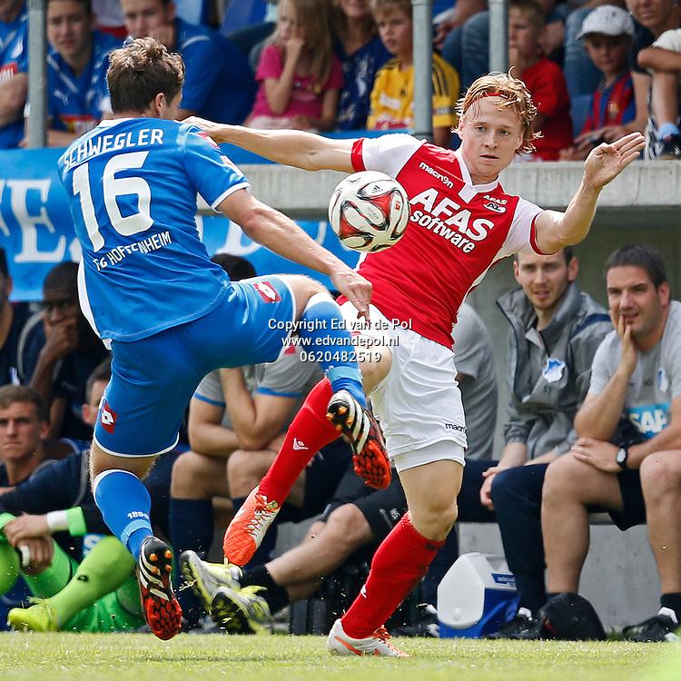 WEGGIS - 31-07-2014 - Hoffenheim - AZ,  Thermoplan Arena, oefenwedstrijd, 3-0, AZ speler Guus Hupperts (r), Pirmin Schwegler (l).