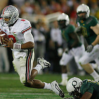 Ohio State's Terrelle Pryor is tripped up the Oregon's Kenny Rowe during the Buckeyes' 26-27 victory in the 96th Rose Bowl game, in Pasadena, Calif., on New Year's Day.
