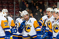 KELOWNA, CANADA - DECEMBER 1: Dawson Davidson #4 of the Saskatoon Blades celebrates the overtime winning goal against the Kelowna Rockets on December 1, 2018 at Prospera Place in Kelowna, British Columbia, Canada.  (Photo by Marissa Baecker/Shoot the Breeze)