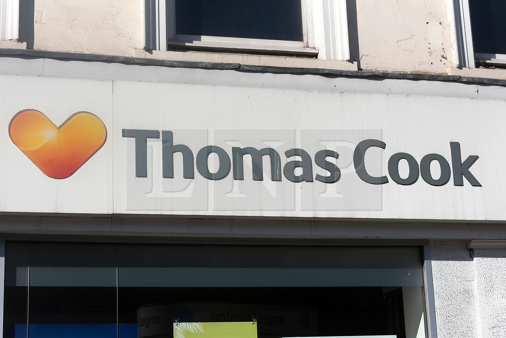 © Licensed to London News Pictures. 23/09/2019. London, UK.  A closed Thomas Cook holiday store logo in North London. British holiday package firm Thomas Cook announced it is in administration.The company failed to raise an additional £200 million of funds to secure a rescue package was not forthcoming.Photo credit: Ray Tang/LNP