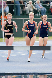 Ellen Ries (left) of Missouri approaches the water hazard with Suzanne Ginnow (center) and Samantha Stafford of Virginia in the women's 3000m steeplechase.  The Virginia Cavaliers men's and women's track and field teams hosted the Missouri Tigers.  The Virginia women defeated Missouri while the Mizzou men defeated UVA on April 5, 2008 at The University of Virginia's Lannigan Field in Charlottesville, VA.