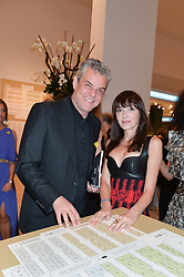 DANNY HUSTON and ANNABELLE NEILSON at the Masterpiece Marie Curie Party supported by Jeager-LeCoultre held at the South Grounds of The Royal Hospital Chelsea, London on 30th June 2014.
