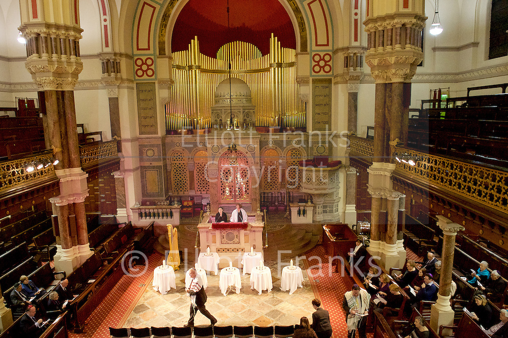 Eve of Holocaust Memorial Day Service at West London Synagogue, London, Great Britain <br /> 26th January 2015 <br /> <br /> Holocaust Memorial candle lit by: <br /> <br /> Peter Tatchell - Speaking Out for Human Rights <br /> <br /> Rabbi Helen Freeman<br /> <br /> Vava Tampa from Congo <br /> <br /> <br /> <br /> Photograph by Elliott Franks <br /> Image licensed to Elliott Franks Photography Services
