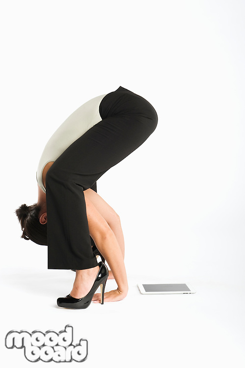 Woman exercising with tablet pc on side