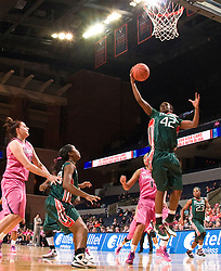 Miami (FL) forward Shenise Johnson (42) grabs a rebound against UVA.  The #21 ranked Virginia Cavaliers defeated the Miami Hurricanes 85-74 in overtime at the John Paul Jones Arena in Charlottesville, VA on February 19, 2009.