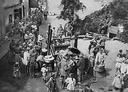World War I 1914-1918: German mobile field kitchen  handing out food  to the local population in a village. Vosges, Lorraine, 1916. Warfare Civilian Hardship Suffering