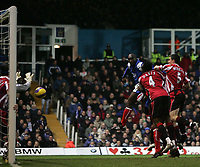 Photo: Lee Earle.<br /> Portsmouth v Sheffield United. The Barclays Premiership. 23/12/2006. Portsmouth's Sol Campbell (L of the Right group of players) heads past United keeper Paddy Kenny to score their second.