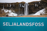 A sign by Seljalandsfoss waterfall, South Iceland.
