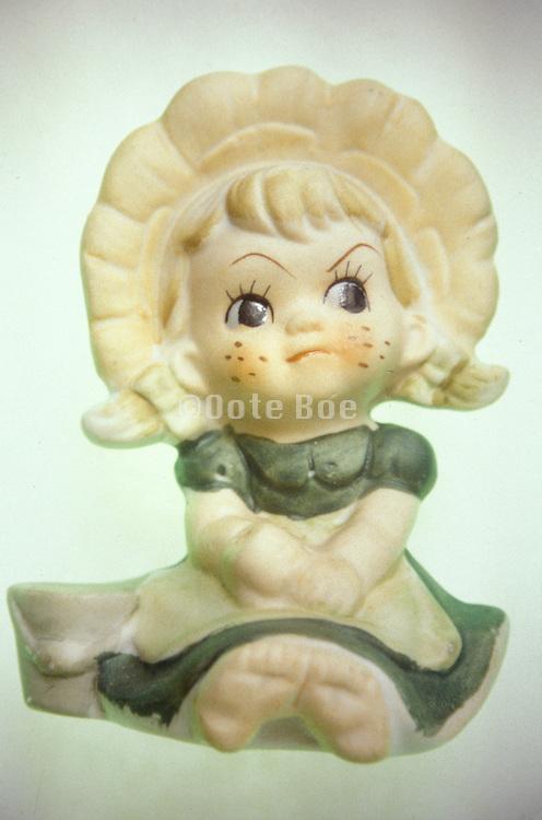 a funny porcelain figure