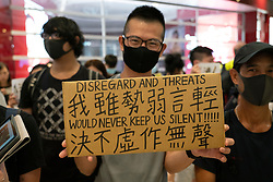 Tuen Mun, Hong Kong. 22 September 2019. Pro democracy demonstration and march through Tuen Mun in Hong Kong. Marchers protesting against harassment by sections of the pro Beijing community. Largely peaceful march had several violent incidents with police using teargas. Several arrests were made. Pictured;  Protest in Yuen Long YoHo Mall.  Iain Masterton Live News.