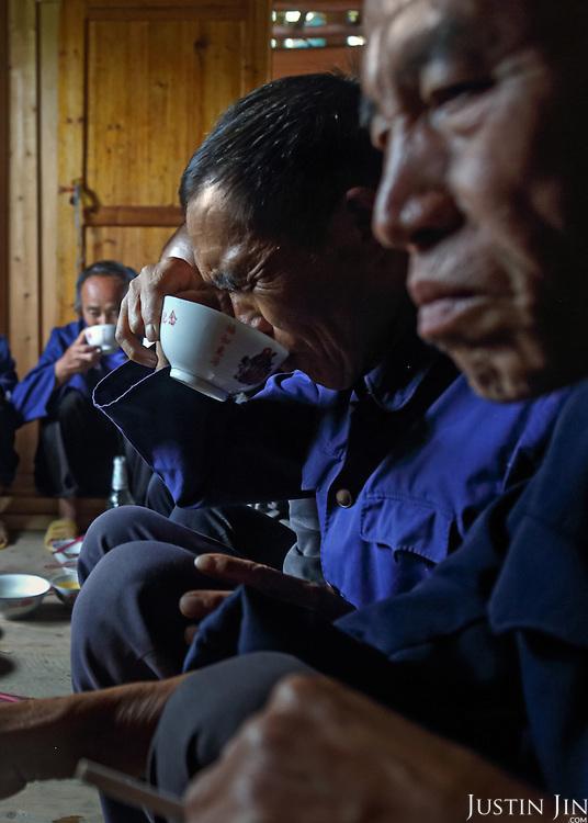 Men drink rice spirit during the celebration.