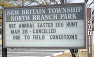A sign shows that the borough easter Egg Hunt was cancelled, Saturday March 28, 2015 at North Branch Park in New Britain Township, Pennsylvania. The New Britain East Egg Hunt was cancelled due to field conditions. (Photo by William Thomas Cain/Cain Images)