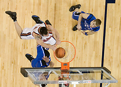 Virginia's Jason Cain (33) dunks over Duke's Josh McRoberts (2).  The University of Virginia Cavaliers beat the #8 ranked Duke University Blue Devils 68-66 in overtime at the John Paul Jones Arena in Charlottesville, VA on February 1, 2007...