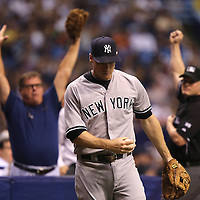 New York Yankees third baseman Chase Headley (12) makes a diving catch into the fans seats during  a major league baseball game between the New York Yankees and the Tampa Bay Rays at Tropicana Field on Thursday, Sept. 17, 2014 in St. Petersburg, Florida. (AP Photo/Alex Menendez)