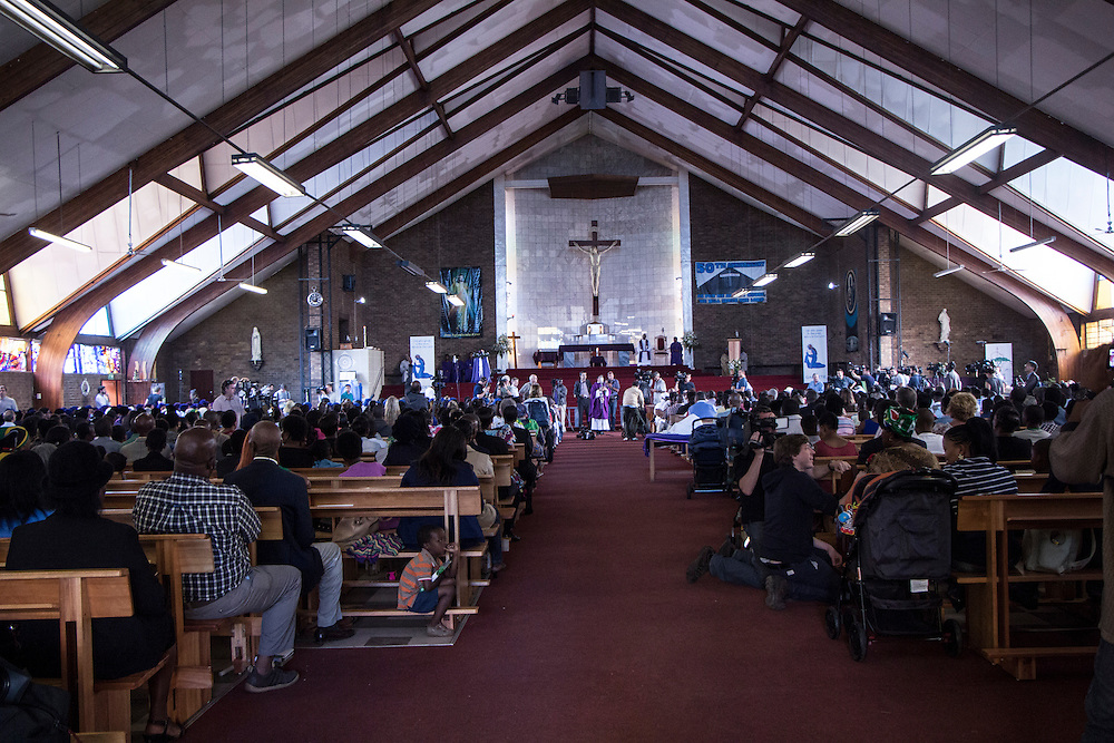 Parishioners filled the Regina Mundi church in Soweto to attend a service for late former South African President Nelson Mandela on the national day of prayer and reflection, on Sunday Dec.8, 2013.