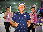 24 NOVEMBER 2018 - BANGKOK, THAILAND:  A man dances in front of the Royal Thai Navy pavilion at the Red Cross Fair. The Red Cross Fair is a fund raiser and annual event in Bangkok that draws thousands of attendees every night of its nine day run. The fair features games of chance, a midway with rides, handicrafts and food. This is the first year the fair has been in Lumpini Park. Previously it had been held in the Dusit section of Bangkok. The 2018 Fair marks 125 years of service for the Red Cross in Thailand.    PHOTO BY JACK KURTZ