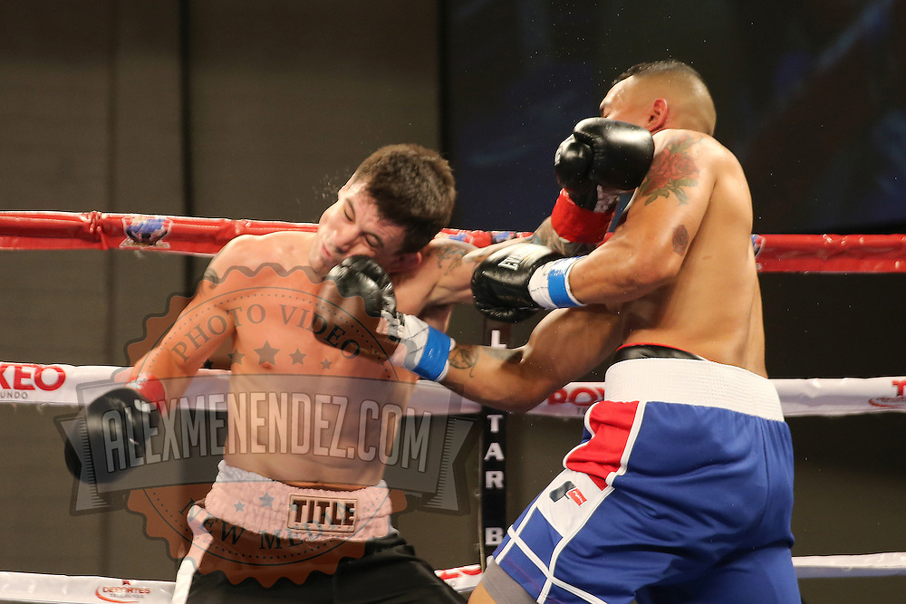 KISSIMMEE, FL - MARCH 06:  Fernando Martinez (R) punches Anthony Way during the Telemundo Boxeo boxing match at the Kissimmee Civic Center on March 6, 2015 in Kissimmee, Florida. (Photo by Alex Menendez/Getty Images) *** Local Caption *** Fernando Martinez; Anthony Way
