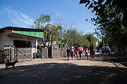 A group of young girls walking to their community library, Biblioteca Comunitaria do Arquipelago, Porte Alegre, Brazil. <br /> <br /> Cirandar is working in partnership with  C&A and C&A Instituto to implement a network of Community Libraries in eight communities of Porto Alegre.
