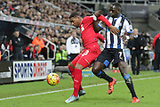 Liverpool's Midfielder Emre Can shields the ball from Newcastle United's Midfielder Moussa Sissoko  during the Barclays Premier League match between Newcastle United and Liverpool at St. James's Park, Newcastle, England on 6 December 2015. Photo by George Ledger.