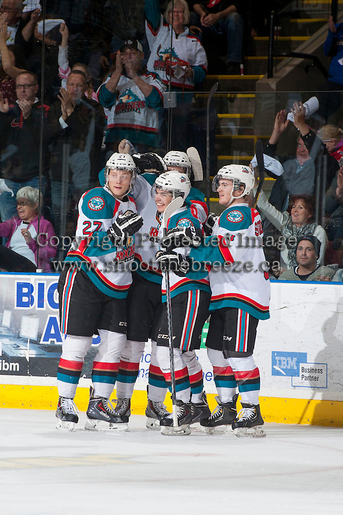 KELOWNA, CANADA - APRIL 19: The # of the Kelowna Rockets celebrate a goal against the Portland Winterhawks on April 18, 2014 during Game 2 of the third round of WHL Playoffs at Prospera Place in Kelowna, British Columbia, Canada.   (Photo by Marissa Baecker/Shoot the Breeze)  *** Local Caption *** goal; Ryan Olsen; Nick Merkley; Riley Stadel;