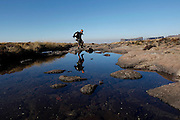 Walkers use the stepping stones to cross the Tugela falls at the top of the Amphitheatre. Royal Natal National Park. Kwa-Zulu Natal, South Africa..© Zute Lightfoot.Zute & Demelza Lightfoot.www.lightfootphoto.com