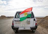 Iraq, Kurdistan, Kirkuk, peshmerga car with a kurdish flag