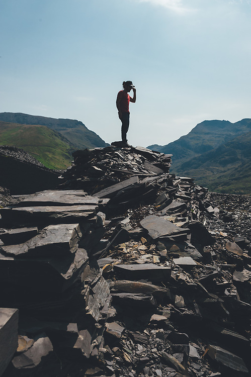 Backpackers in the path visiting the ancient Dinorwic Quarry at Snowdonia National Park in North Wales.