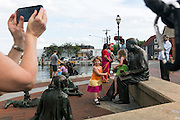 "Annapolis, Maryland - June 05, 2016: Cate Miller DeMartino, from McLean, Va. takes a picture on her phone of her daughter Emery DeMartino, 4, (in the tri-colored dress) playing alongside Payton Womble, also 4, from Severna Park, Md. on the Kunta Kinte-Alex Haley Memorial statue in historic Annapolis Sunday June 5th, 2016.  Earlier that day a perigean spring tide brought some of the highest water levels of the year to the coastal town and partially flooded the park.<br /> <br /> <br /> A perigean spring tide brings nuisance flooding to Annapolis, Md. These phenomena -- colloquially know as a ""King Tides"" -- happen three to four times a year and create the highest tides for coastal areas, except when storms aren't a factor. Annapolis is extremely susceptible to nuisance flooding anyway, but the amount of nuisance flooding has skyrocketed in the last ten years. Scientists point to climate change for this uptick. <br /> <br /> <br /> CREDIT: Matt Roth for The New York Times<br /> Assignment ID: 30191272A"