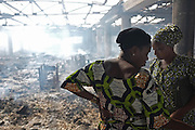 LOME, TOGO -  13-01-12   - Two women react to the destruction of Lome's Grand Marche on January 12 after it engulfed in flames late on January 11, 2013. Photo by Daniel Hayduk