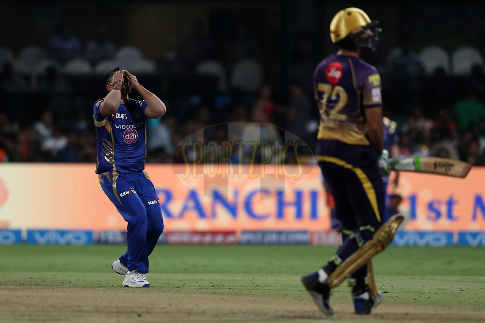 Karn Sharma of the Mumbai Indians reacts after a delivery during the 2nd qualifier match of the Vivo 2017 Indian Premier League between the Mumbai Indians and the Kolkata Knight Riders held at the M.Chinnaswamy Stadium in Bangalore, India on the 19th May 2017<br /> <br /> Photo by Ron Gaunt - Sportzpics - IPL