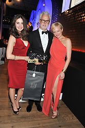 Left to right, ALISON BRIE, JOHN SLATTERY winner of the GQ International Man of The Year Award and ELISABETH MOSS at the GQ Men of The Year Awards 2012 held at The Royal Opera House, London on 4th September 2012.