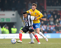 Grimsby's Nathan Arnold holds off Bristol Rovers' Matty Taylor - Photo mandatory by-line: Neil Brookman/JMP - Mobile: 07966 386802 - 14/02/2015 - SPORT - Football - Cleethorpes - Blundell Park - Grimsby Town v Bristol Rovers - Vanarama Football Conference