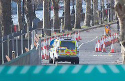 © Licensed to London News Pictures. 14/12/2019. London, UK. A police vehicle is parked on Chelsea Embankment next to the Thames Tideway sewer works building site on The River Thames after a controlled explosion was carried out on a WW2 unexploded bomb. Photo credit: Peter Macdiarmid/LNP