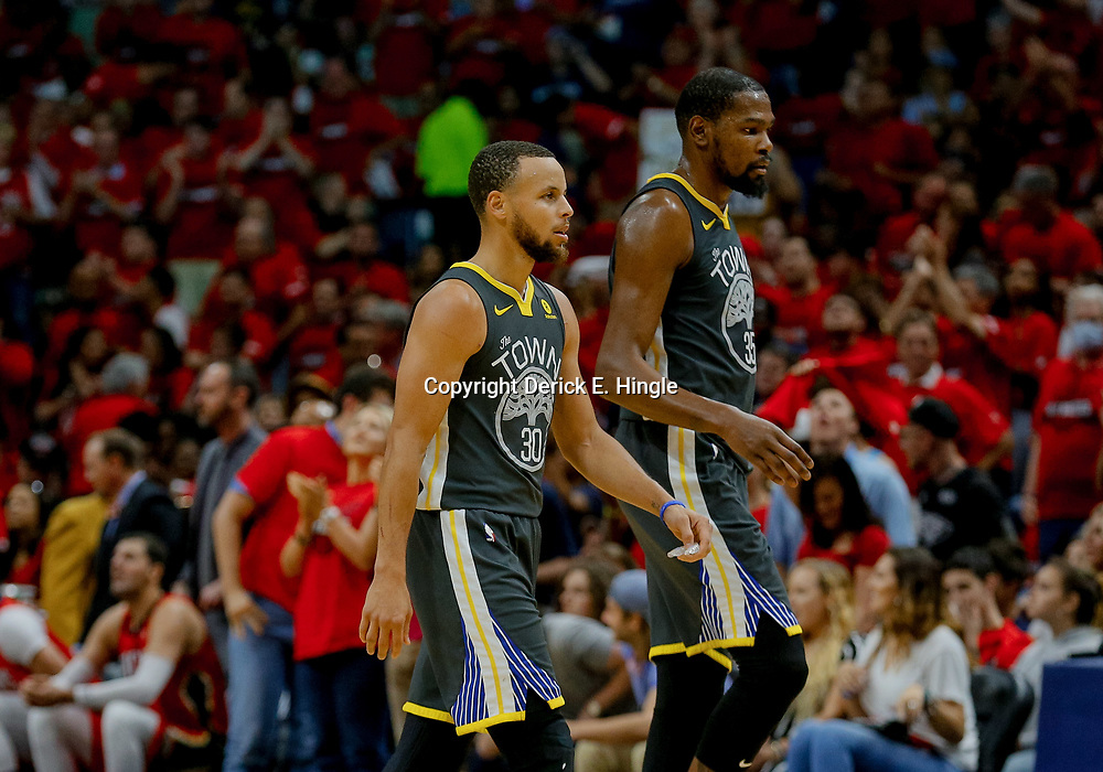 May 6, 2018; New Orleans, LA, USA; Golden State Warriors guard Stephen Curry (30) and forward Kevin Durant (35) during the second quarter in game four of the second round of the 2018 NBA Playoffs against the New Orleans Pelicans at the Smoothie King Center. Mandatory Credit: Derick E. Hingle-USA TODAY Sports