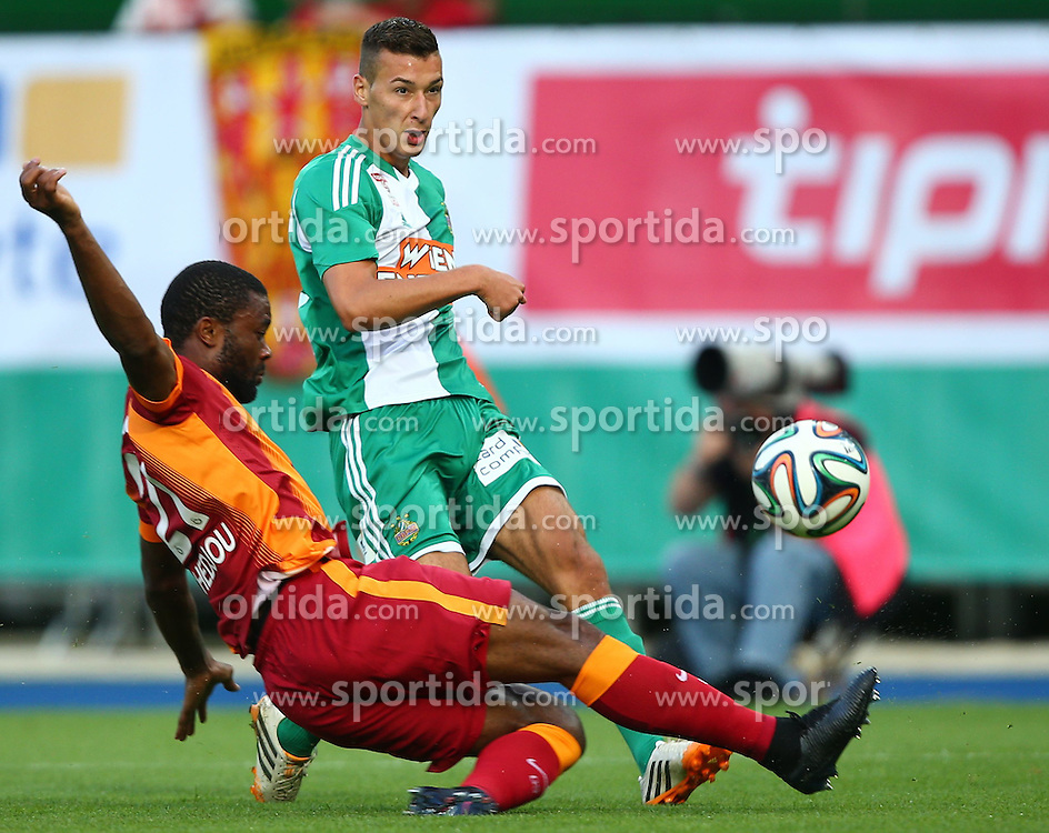23.07.2014, Ernst Happel Stadion, Wien, AUT, Testspiel, SK Rapid Wien vs Galatasaray Istanbul, im Bild Aurelien Chedjou, (Galatasaray Istanbul, #21) und Dominik Wydra, (SK Rapid Wien, #25) // during a Austrian Bundesliga Football test match between SK Rapid Vienna and Galatasaray Istanbul at the Ernst Happel Stadion, Wien, Austria on 2014/07/23. EXPA Pictures © 2014, PhotoCredit: EXPA/ Thomas Haumer