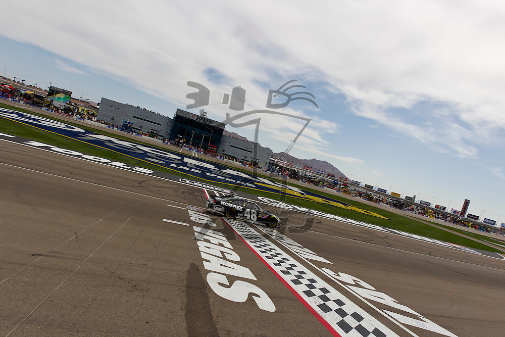 LAS VEGAS, NV - MAR 11, 2012:  Jimmie Johnson (48) crosses the finish line at the Kobalt Tools 400 NASCAR race in Las Vegas, NV.