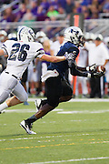 Hendrickson's Craig Roberts-Shearn makes a running catch and scored a  touchdown against Cedar Ridge Friday at Hawk Stadium.  The Hawks led the Raiders 27-6 at the half.  LOURDES M SHOAF/Round Rock Leader