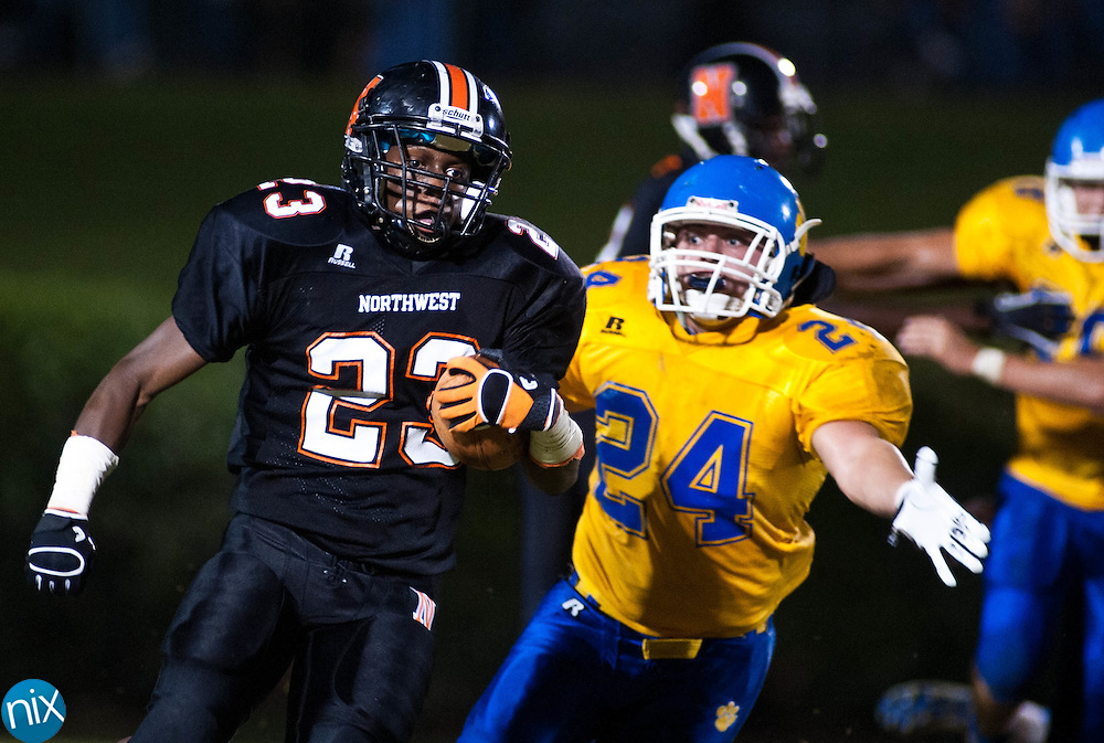 Northwest Cabarrus' Jalen Caldwell carries the ball against Mount Pleasant Friday night at Northwest Cabarrus High School. (Photo by James Nix)