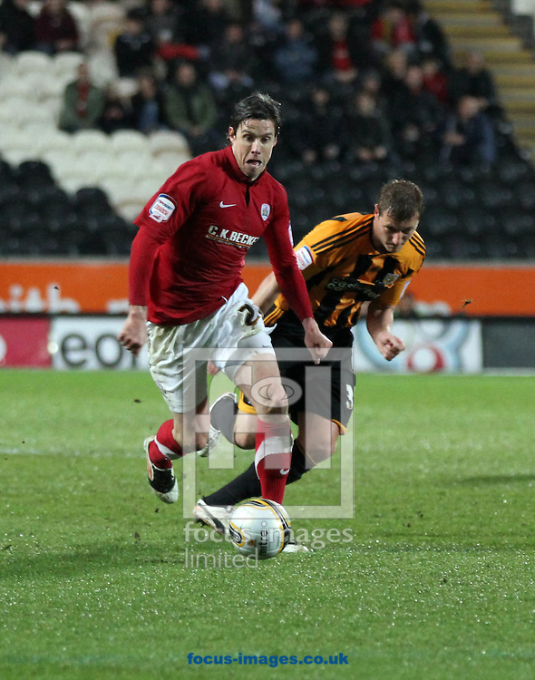 Picture by Richard Gould/Focus Images Ltd. 07710 761829.17/04/12.Andy Gray of Barnsley races away from Liam Cooper of Hull City during the Npower Championship match at KC Stadium, Hull.