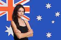 Portrait of young woman against Australian flag