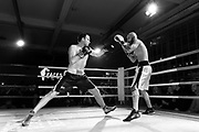 Amateur Chessboxers Daniel Biman (left) and Mohamad Khadijah are engaged in a round of boxing during a chessboxing match at the Intellectual Fight Club in Berlin, Germany on the 15th of December 2017. <br />