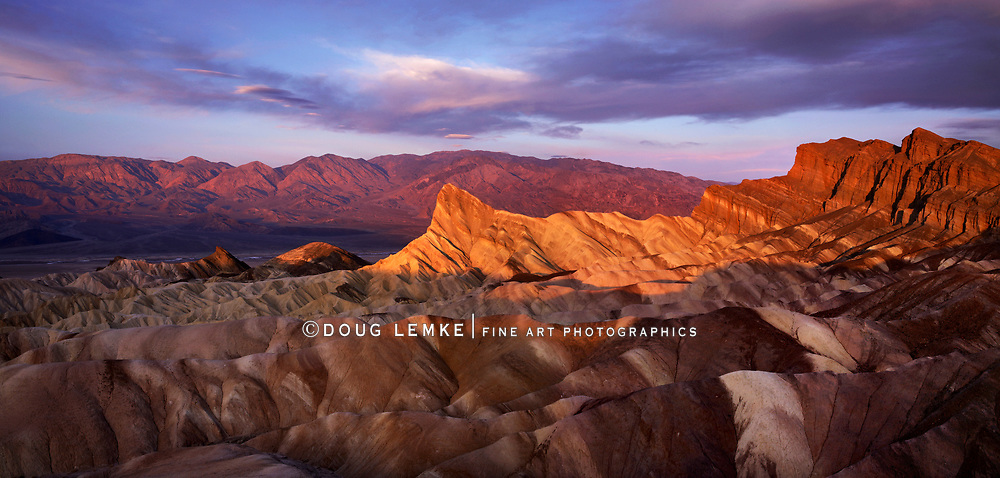 The First Light Of Dawn Over Zabriskie Point At Death Valley National Park, California, USA