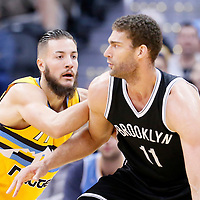 04 March 2016: Denver Nuggets center Joffrey Lauvergne (77) defends on Brooklyn Nets center Brook Lopez (11) during the Brooklyn Nets 121-120 victory over the Denver Nuggets, at the Pepsi Center, Denver, Colorado, USA.
