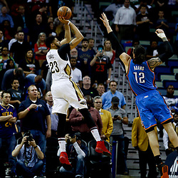 Jan 25, 2017; New Orleans, LA, USA; New Orleans Pelicans forward Anthony Davis (23) shoots over Oklahoma City Thunder center Steven Adams (12) during the first quarter of a game at the Smoothie King Center. Mandatory Credit: Derick E. Hingle-USA TODAY Sports