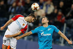 November 23, 2017 - Saint Petersburg, Russia - Artem Dzyuba (R) of FC Zenit Saint Petersburg and Hovhannes Hambartsumyan of FK Vardar vie for a header during the UEFA Europa League Group L match between FC Zenit St. Petersburg and FK Vardar at Saint Petersburg Stadium on November 23, 2017 in Saint Petersburg, Russia. (Credit Image: © Mike Kireev/NurPhoto via ZUMA Press)
