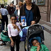 African American Mother with two children waiting in line out doors to get into to Vote for 2008 Presidental Election, Democratic and Repubication parties canidates, Barack Obama and Joe Biden, John McCain and Sarah Palin