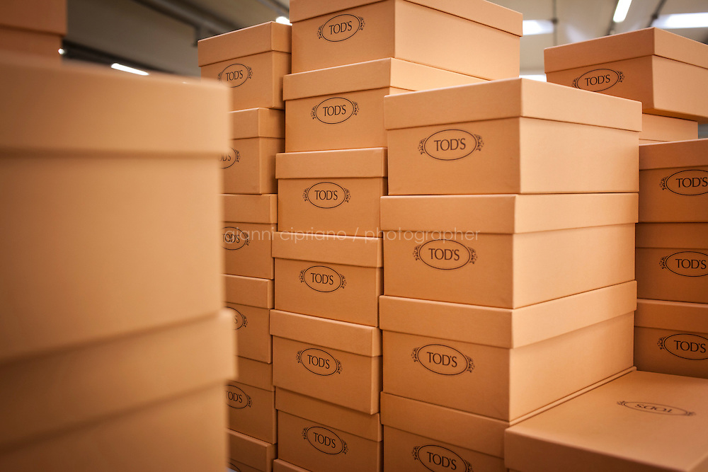 SANT'ELPIDIO A MARE, ITALY - MAY 20: Piled shoe boxes at the Tod's headquarters in Sant'Elpidio a Mare (FM, Marche), Italy, on May 20, 2011. The Tod's headquarters was designed by Della Valle's wife Barbara Pistilli and was inaugurated in 1998. Tod's Group is an Italian company which produces shoes and other leather goods, and is presided over by businessman Diego Della Valle. It is most famous for its driving shoes.<br /> <br /> Gianni Cipriano for Le Monde