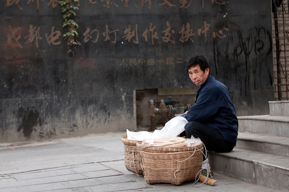 A man sells food on the street in Chengdu, China.
